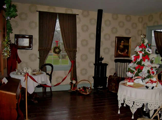 Yje Ladies parlor is decotated with a Victorian English display
